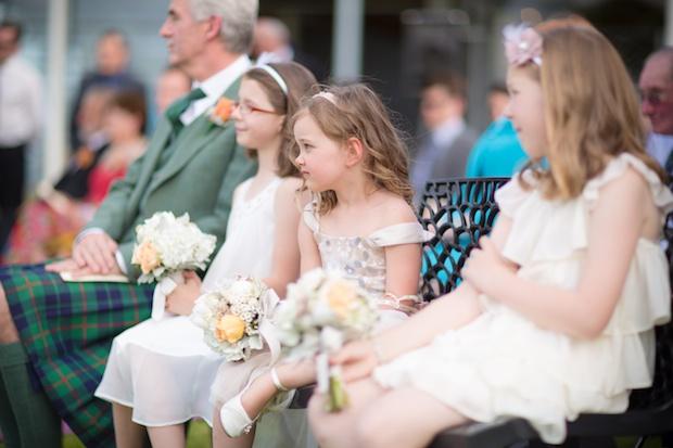 Flowergirl handing over the wedding ring
