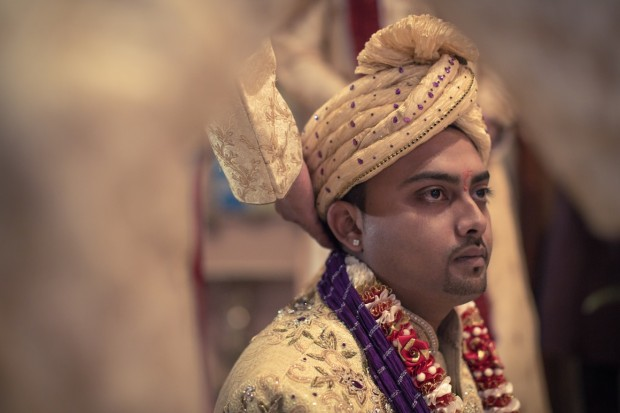 Focused groom at indian wedding ceremony
