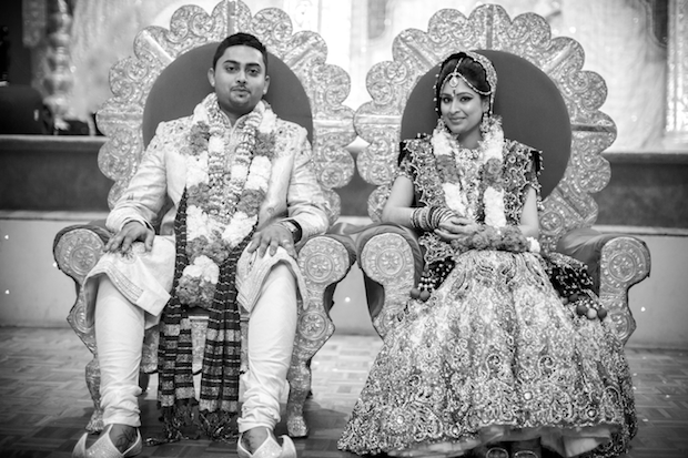 Indian wedding couple on throne