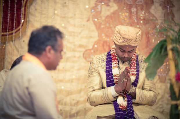 wedding photography - groom praying at ceremony