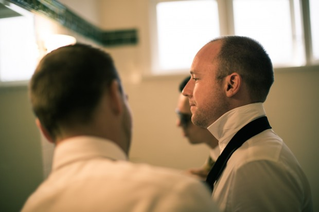groom getting ready - tie